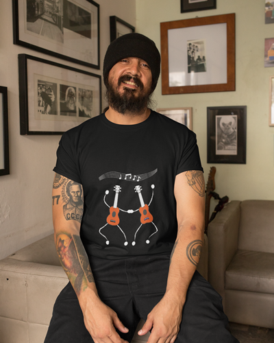Ukulele Music Tshirt on black T-shirt - bearded guy wearing dark Tee with drawing of two ukuleles dancing under musical notes